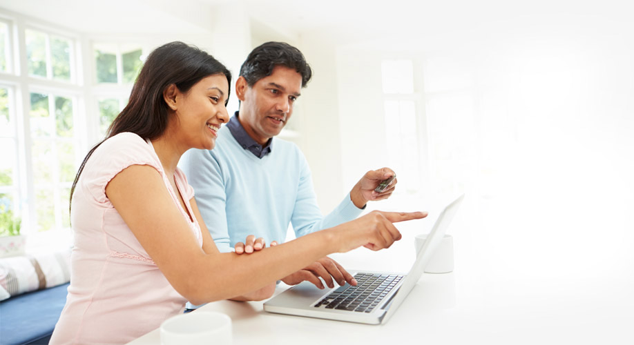 RA-stock-couple-south-asian-laptop-hi-res-56330140-2